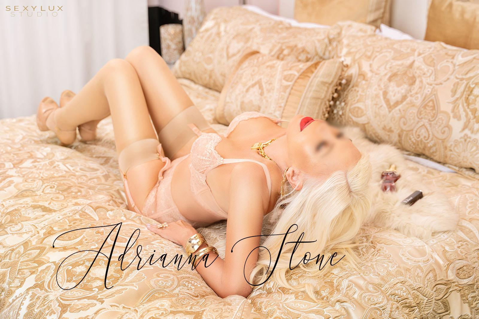 Sexy blonde Latina Miami escort in black lingerie
